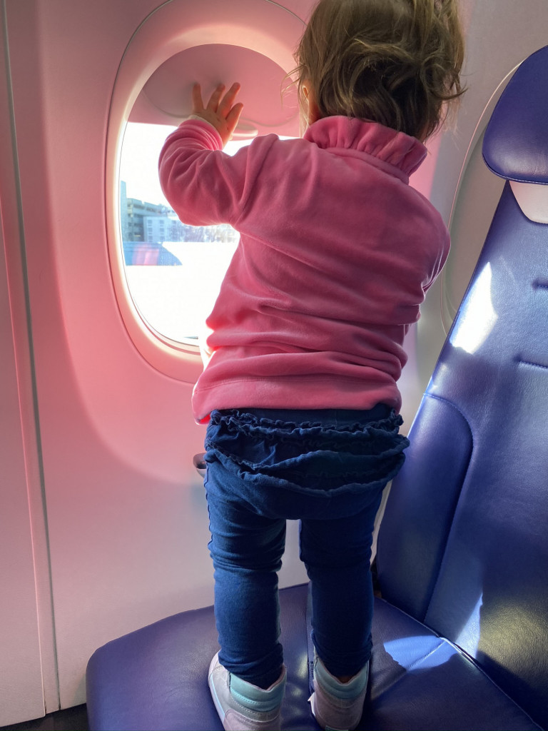 Baby on an airplane, looking out the window